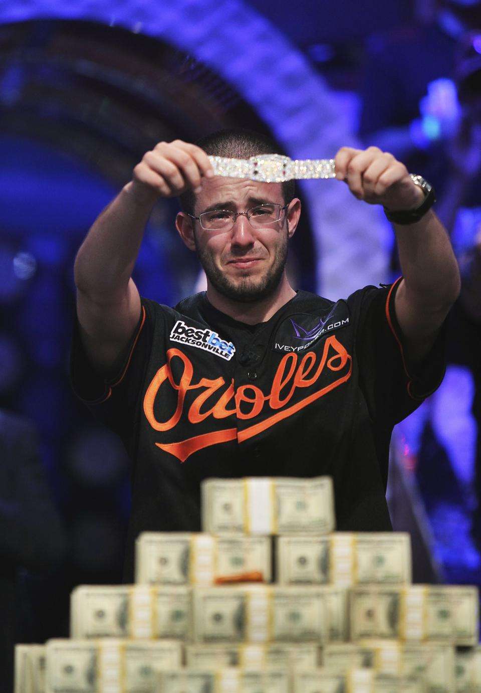 Greg Merson holds up his new bracelet after winning the World Series of Poker No-Limit Hold'em Main Event, Wednesday, Oct. 31, 2012, in Las Vegas. (AP Photo/Las Vegas Review-Journal, Jason Bean) LOCAL TV OUT; LOCAL INTERNET OUT; LAS VEGAS SUN OUT