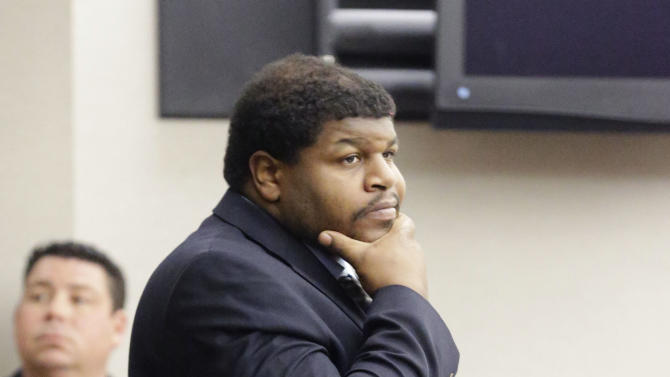 Former Dallas Cowboys NFL football player Josh Brent enters court to face sentencing for his intoxication manslaughter conviction in Dallas, Friday, Jan. 24, 2014. Brent was sentenced to 180 days in jail and 10 years of probation for a drunken car crash that killed his friend and teammate, Jerry Brown. Brent could have been sentenced to up to 20 years in prison. (AP Photo/Pool/LM Otero, Pool)