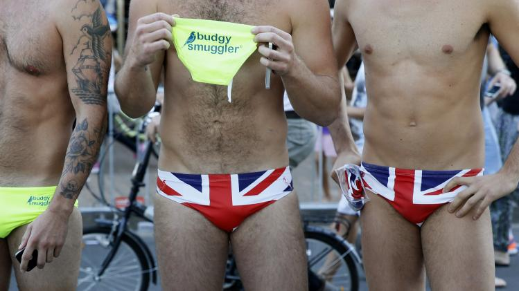 Men pose in swimming trunks depicting the Union Jack, as they wait for Britain's Prince William and his wife Catherine, the Duchess of Cambridge, to arrive at Manly beach in Sydney