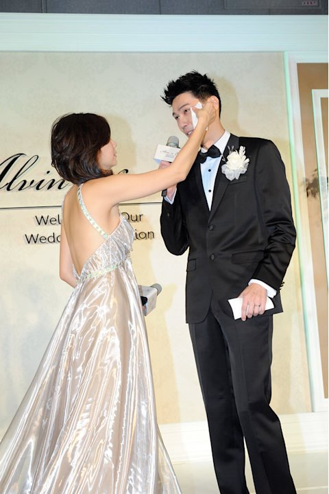 "The couple, who have been dating for over a year, exchanged rings and said ""I do"" in front of fifty tables of close friends and relatives at the wedding held at the Le Meridien Taipei."