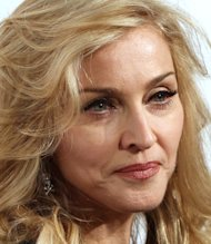 Madonna courts controversy with gun-wielding stage routine