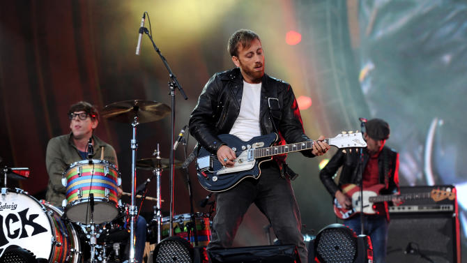 FILE - In this Sept. 29, 2012, file photo, guitarist Dan Auerbach, center, and drummer Patrick Carney of The Black Keys perform at the Global Citizen Festival in Central Park in New York. (AP Photo by Evan Agostini/Invision/AP, File)