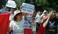 Protesters shout anti-China slogans while marching in the center of Hanoi, on August 5, amid tensions over territorial disputes in the South China Sea. Vietnamese police forcefully broke up the rally, arresting at least 20 people