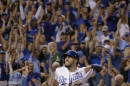 Kansas City Royals' Eric Hosmer celebrates after scoring on a single by Christian Colon during the 12th inning of the AL wild-card playoff baseball game against the Oakland Athletics on Tuesday, Sept. 30, 2014, in Kansas City, Mo. (AP Photo/Charlie Riedel)