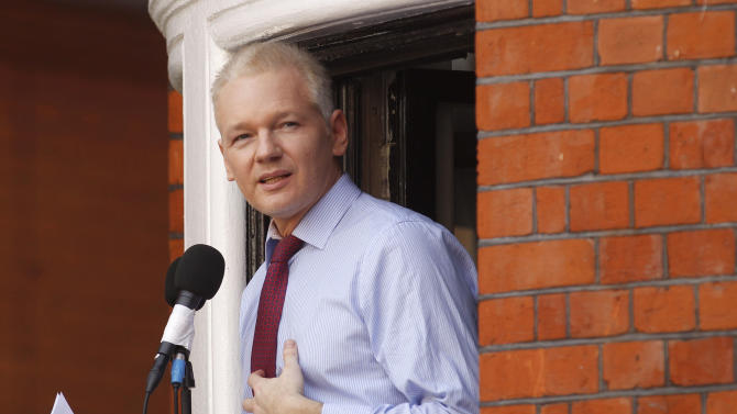 FILE - This is a Sunday, Aug. 19, 2012 file photo of  WikiLeaks founder Julian Assange as he  makes a statement to the media and supporters at a window of Ecuadorian Embassy in central London. A British judge on Monday Oct. 8, 2012  ordered supporters of Julian Assange to pay thousands of pounds they promised for his bail because the WikiLeaks founder violated the conditions for his release.  (AP Photo/Sang Tan, File)
