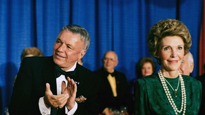 FILE -  In this Oct. 19, 1985 file photo, singer Frank Sinatra applauds next to first lady Nancy Reagan at the National Italian-American Foundation's 10th Anniversary Gala in Washington.  Sinatra, who died in 1998, at 82, would have celebrated his 100th birthday on Dec. 12, 2015. (AP Photo, File)