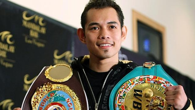 Nonito Donaire of the Philippines poses with his belts during a post fight news conference after defeating WBC/WBO bantamweight champion Fernando Montiel of Mexico at the Mandalay Bay Events Center in Las Vegas, Nevada, February 19, 2011