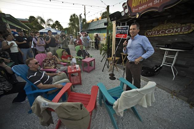 FILE - This Nov. 23, 2013 file photo shows Florida Republican Congressional candidate David Jolly, right, speaking in Indian Rocks Beach, Fla. The special election in this stretch of coastal beach tow