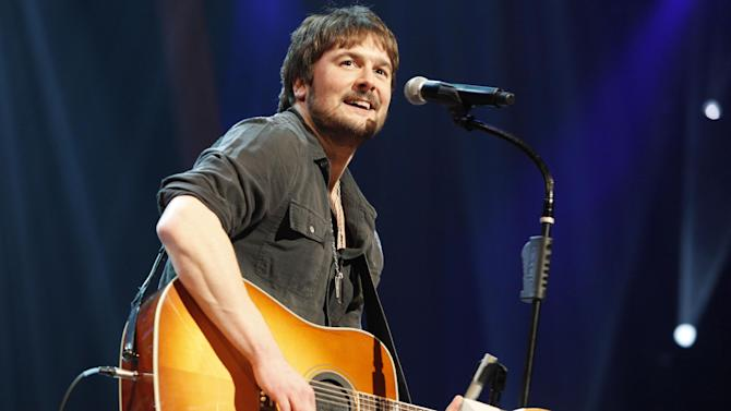 FILE - In this March 18, 2011 file photo, country singer Eric Church performs at the Grand Ole Opry in Nashville, Tenn. Church is the top nominee with seven nominations at the upcoming 48th annual Academy of Country Music Awards. The show will broadcast live on CBS from the MGM Grand Garden Arena in Las Vegas on Sunday, April 7, 2013. (AP Photo/Ed Rode, File)