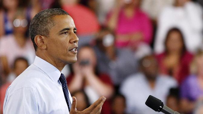 FILE - In this Aug. 22, 2012 file photo, President Barack Obama speaks during a campaign stop in North Las Vegas, Nev. Barack Obama needs to remind voters why they loved him in 2008. Mitt Romney needs for voters to get to know and like him better And both must strike a balance with their conventions to fire up core backers without alienating undecided voters who may well decide a close election.  (AP Photo/Isaac Brekken, File)