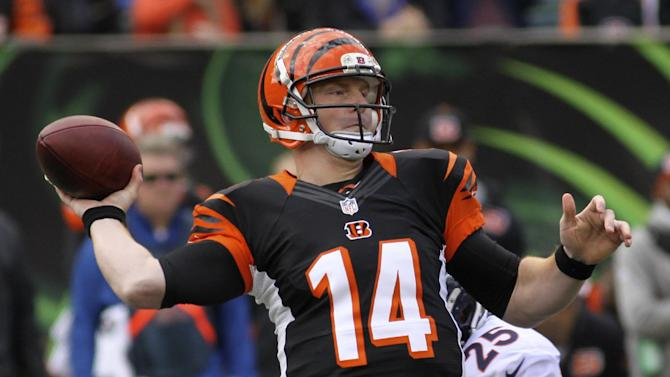 Cincinnati Bengals quarterback Andy Dalton (14) passes under pressure from Denver Broncos cornerback Chris Harris (25) in the first half of an NFL football game, Sunday, Nov. 4, 2012, in Cincinnati. (AP Photo/Tom Uhlman)