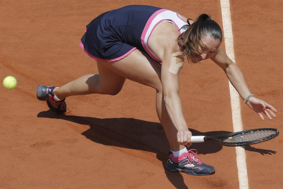 Serbia's Jelena Jankovic eyes the ball after returning against Russia's Maria Sharapova in their quarterfinal match at the French Open tennis tournament, at Roland Garros stadium in Paris, Wednesday June 5, 2013. (AP Photo/Christophe Ena)