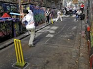 File photo shows Indian students playing police officers in a game of laneway cricket in Melbourne. India has topped Britain and China to become Australia's leading source of migrants for the first time, data revealed Friday, with seven of the top 10 source countries now in Asia