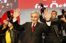Austrian Chancellor and leader of the Social Democratic Party Faymann addresses supporters after first projections in the Austrian general election in Vienna