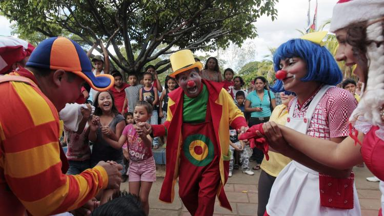 Clowns dance with children at the entrance of the La Mascota children's hospital in Managua