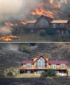 This photo combination shows a house on a hillside above Bettas Road near Cle Elum, Wash., surrounded by flames on Tuesday, Aug. 14, 2012, top, and on Wednesday, Aug. 15, 2012, bottom. A spokesman for the Washington state Department of Natural Resources said the house survived the fire because of the defensible space around the structure with the placement of the driveway and the lack of trees and brush up against the house, preventing flames from reaching it. Firefighters are still working to control the Bridge Taylor Fire and said that it's 25 percent contained. (AP Photo/Elaine Thompson)