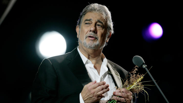 "FILE - In this Oct. 4, 2008 file photo,Tenor Placido Domingo performs in concert at the Mayan ruins of Chichen Itza in the Yucatan peninsula in Mexico. American television audiences will see something unique this week — filmed live in the streets and palaces of an Italian city: Verdi's ""Rigoletto"" with Placido Domingo, singing right where the story is set. The performance starts Friday, July 15, 2011 at 9:30 PM EDT.  (AP Photo/Israel Leal, File)"