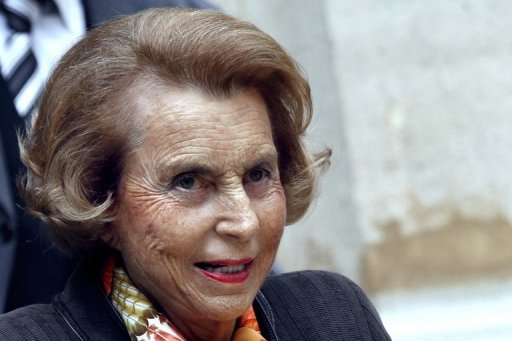 <p>L'Oreal heiress Liliane Bettencourt leaves the Institut de France in October 2011. French police have detained Bettencourt's ex-lawyer and a businessman for questioning in a probe into allegations of abuse of power, a source close to the matter has told AFP.</p>