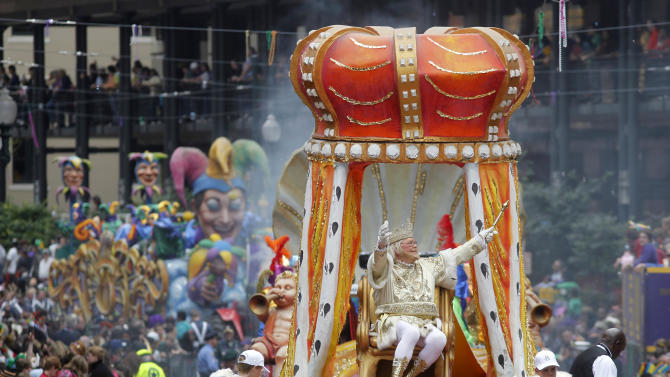 "FILE - In this March 8, 2011 file photo, Rex, the King of Carnival rides in the Krewe of Rex as he arrives at Canal St. on Mardi Gras day in New Orleans. With the Super Bowl in New Orleans Feb. 3 and Mardi Gras falling just nine days later, the city is gearing up for a massive celebration and influx of tourists that locals are calling ""Super Gras.""  (AP Photo/Gerald Herbert, file)"
