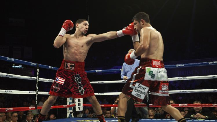WBC unified super lightweight champion Danny Garcia of the U.S. punches Mauricio Herrera of the U.S. during the second round of their championship fight in Bayamon