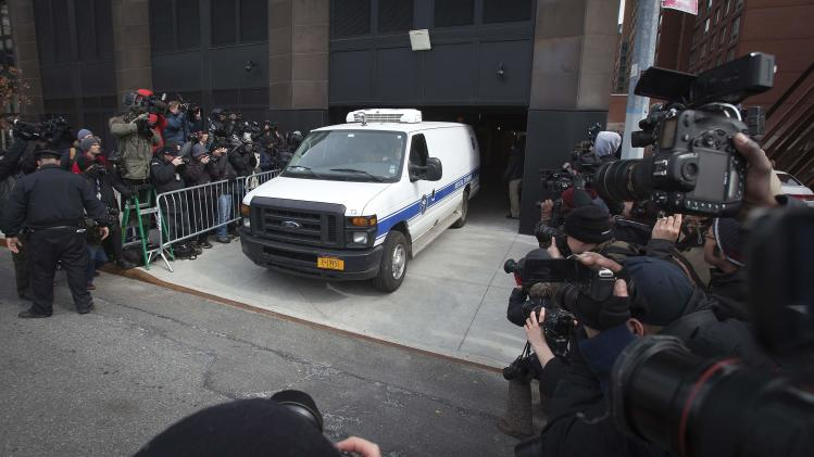 A New York City Medical Examiner van leaves the apartment building of designer L'Wren Scott in the Manhattan borough of New York