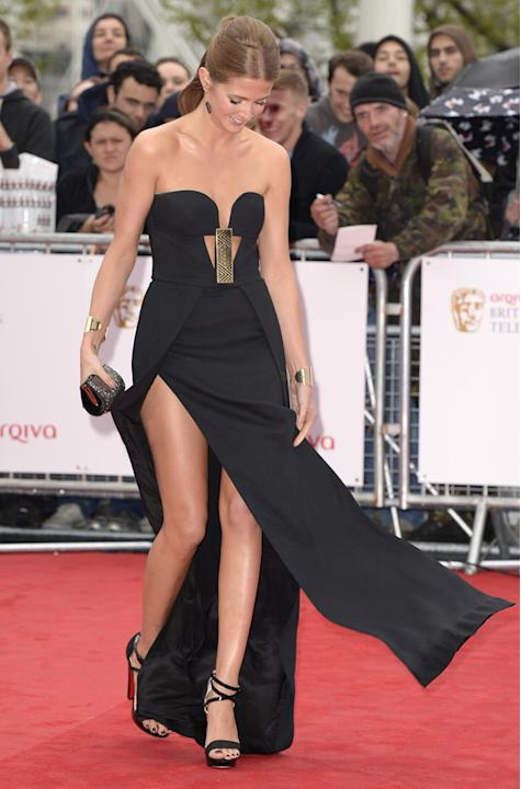 TV BAFTAS 2013 wardrobe malfunctions: Made in Chelsea's Millie Mackintosh made a major error in opting for a dress with massive thigh-high splits. She even took to Twitter after walking the red carpet