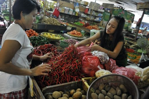 &lt;p&gt;A customer buys chilis at a market in Jakarta. &quot;Food is the biggest driver of inflation... August inflation is due to the Muslim fasting month and Lebaran (Eid celebrations),&quot; the Central Statistics Agency said.&lt;/p&gt;