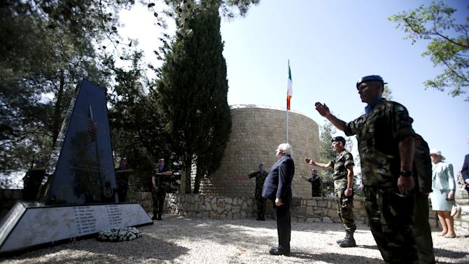 Ireland's President Michael D. Higgins pays his respect at a memorial dedicated to the Irish U.N. peacekeepers who died during service in south Lebanon