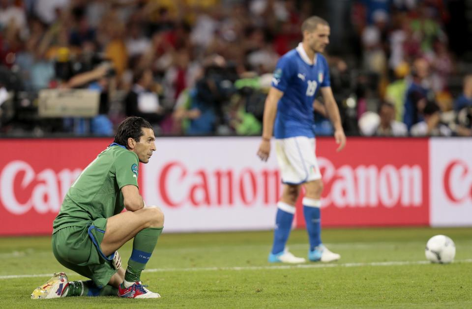 Italy goalkeeper Gianluigi Buffon, left, reacts after Spain's Jordi Alba scored the second goal during the Euro 2012 soccer championship final  between Spain and Italy in Kiev, Ukraine, Sunday, July 1, 2012. (AP Photo/Ivan Sekretarev)
