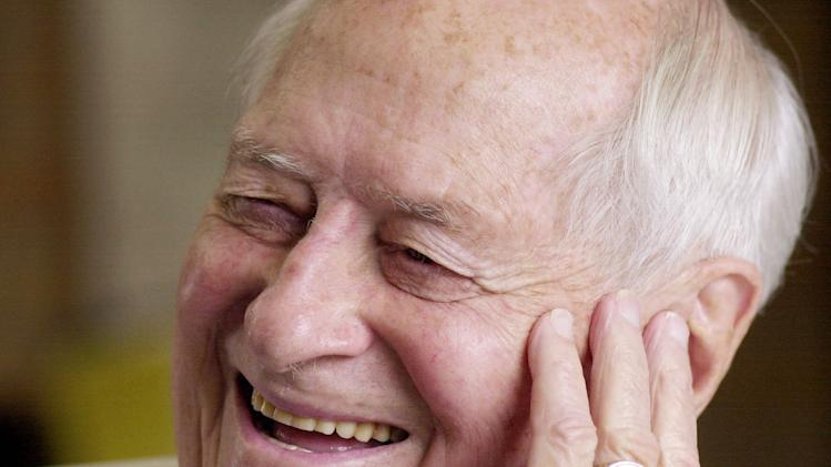 FILE - In this June 11, 2001 file photo, Former Washington Gov. Albert Rosellini smiles during an interview in his Seattle office. Rosellini, who brought an everyman personality and trademark rosebud lapel to the state's top office, died Monday, Oct. 10, 2011. He was 101. (AP Photo/Elaine Thompson, File)