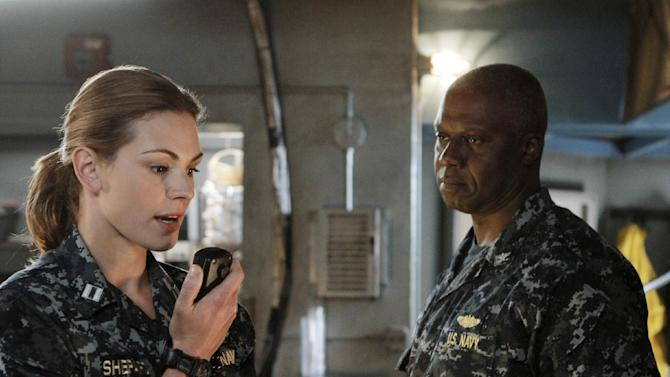 "This image released by ABC shows Daisy Betts as Lieutenant Grace Shepard, left, and Andre Braugher as Captain Marcus Chaplin in a scene from the series ""Last Resort,"" premiering Sept. 27, 2012 at 8 p.m. EST on ABC. (AP Photo/ABC, Mario Perez)"