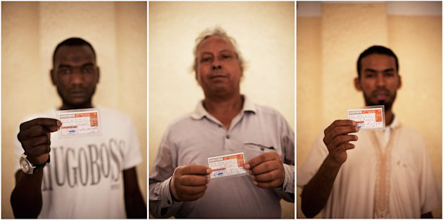 This combo image of three photographs shows Libyan men holding their elections ID at a polling station in Tripoli, Libya, Saturday, July 7, 2012. Jubilant Libyan voters marked a major step toward democracy after decades of erratic one-man rule, casting their ballots Saturday in the first parliamentary election after last year&#39;s overthrow and killing of longtime leader Moammar Gadhafi. But the joy was tempered by boycott calls, the burning of ballots and other violence in the country&#39;s restive east. (AP Photo/Manu Brabo)