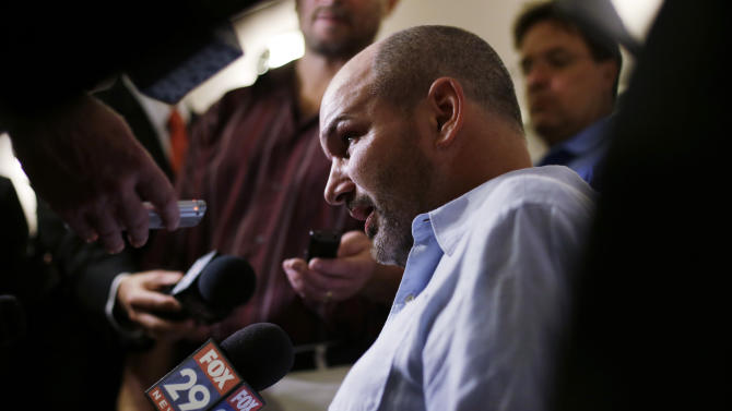 former NFL player Kevin Turner speaks during a news conference Tuesday, April 9, 2013, in Philadelphia, after a hearing to determine whether the NFL faces years of litigation over concussion-related brain injuries. Thousands of former players have accused league officials of concealing what they knew about the risk of playing after a concussion. The lawsuits allege the league glorified violence as the game became a $9 billion-a-year industry. (AP Photo/Matt Rourke)