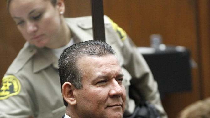Defendant Luis Artiga listens to opening statements in a massive city corruption trial in a downtown Los Angeles courtroom Thursday, Jan. 24, 2013. The former mayor and vice mayor and four former city council members of the Los Angeles suburb of Bell, Calif., are charged with misappropriation of public funds in a plot to line their own pockets at the expense of citizens. Those on trial are former Mayor Oscar Hernandez, former vice mayor Teresa Jacobo, and former council members Artiga and George Mirabal, George Cole, and Victor Bello. (AP Photo/Los Angeles Times, Irfan Khan, Pool)
