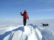 NASA astronaut Stan Love waves while participating in a meteorite hunt in Antarctica during a 2004-2005 expedition by the Antarctic Search for Meteorites Program at Case Western Reserve University. The astronaut ventured back to Antarctica in D