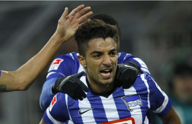 Hertha Berlin's Allagui celebrates a goal against Borussia Dortmund during the German first division Bundesliga soccer match in Dortmund