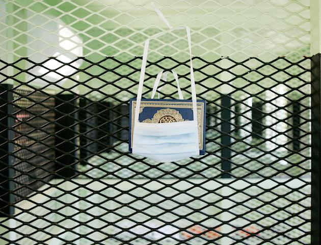 GUANTANAMO BAY, CUBA - MAY 09:  (IMAGE REVIEWED BY U.S. MILITARY PRIOR TO TRANSMISSION)  A Koran hangs in a cell of the Camp 2 cell block at Camp Delta May 9, 2006 in Guantanamo Bay, Cuba. Camp Delta