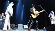 Greg Malone jokes with Ron Hynes on stage at Mile One Centre in St. John's on August 11, 2012.