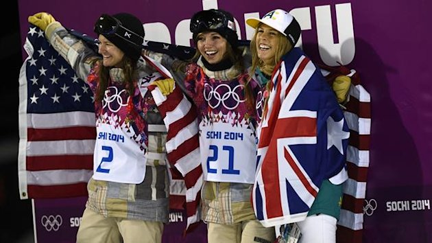 Third-placed Kelly Clark, winner Kaitlyn Farrington, both of the U.S., with second-placed Australia's Torah Bright