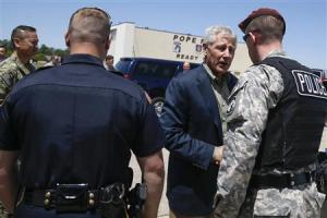 U.S. Defense Secretary Chuck Hagel hands out commander coins before leaving Pope Army Airfield in Fort Bragg, North Carolina