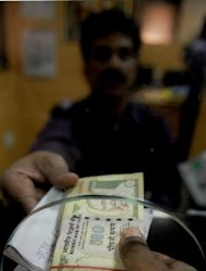 Many analysts are eyeing 60 Indian rupees to the dollar as the next big mark for the currency as lacklustre US data and a worsening European debt crisis prompt risk-averse investors to dump emerging-market assets