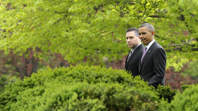 President Barack Obama and 2013 National Teacher of the Year Jeff Charbonneau, who teaches at Zillah High School in Zillah, Wash., arrive for a ceremony in the Rose Garden of the White House in Washington, Tuesday, April 23, 2013. (AP Photo/Susan Walsh)