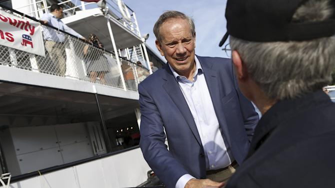 Former New York Governor George Pataki boards the ship for a sunset cruise with the Belknap County Republicans in Laconia