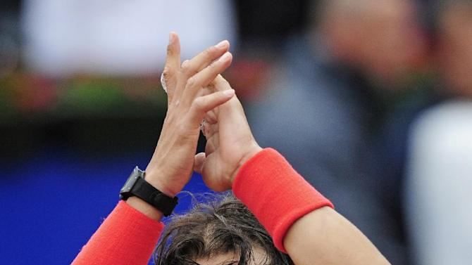 Rafael Nadal of Spain reacts after his victory over Nicolas Almagro during the Barcelona final open tennis in Barcelona, Spain, Sunday, April 28, 2013. Nadal won 6-4, 6-3. (AP Photo/Manu Fernandez)