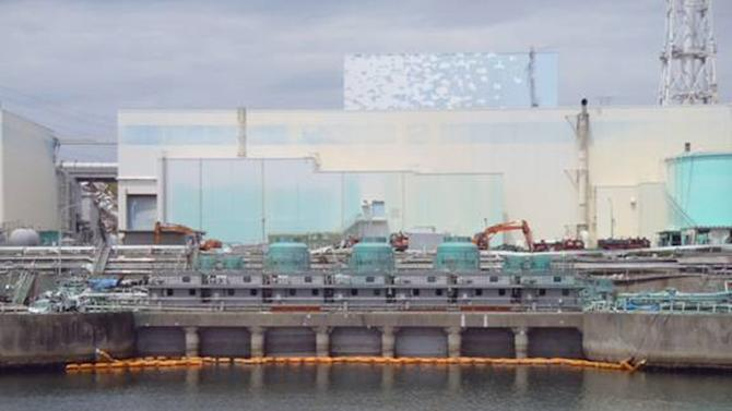 In this June 30, 2011 photo released on July 5, 2011 by Tokyo Electric Power Co., sliding concrete slabs, seen above orange floats, are all set in the upper part of the sluice screen for Unit 2 reactor at the tsunami-crippled Fukushima Dai-ichi nuclear power plant in Okuma, Fukushima Prefecture, northeastern Japan, in TEPCO's effort to decrease the leak of radiation contaminated water to the ocean. (AP Photo/Tokyo Electric Power Co.) EDITORIAL USE ONLY