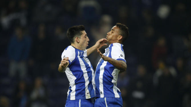 Porto's Danilo celebrates his goal against Setubal with his teammate Herrera at Dragao stadium in Porto