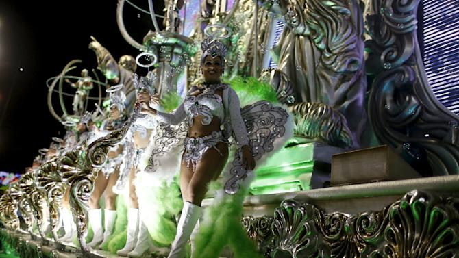 Revellers of Grande Rio samba school perform during the carnival parade at the Sambadrome in Rio de Janeiro