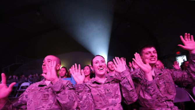 U.S. troops from the Nato-led International Security Assistance Force enjoy a Christmas day concert for U.S. military personnel at Bagram Airfield, north of Kabul