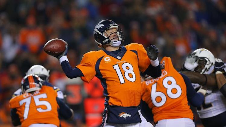 Peyton Manning of the Denver Broncos looks to pass against the San Diego Chargers in the second quarter at Sports Authority Field at Mile High on December 12, 2013 in Denver, Colorado