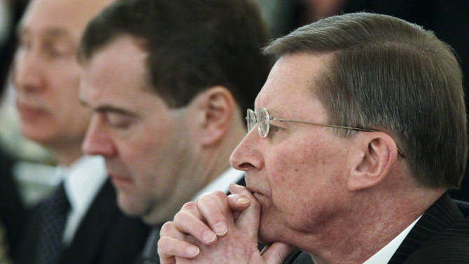 This file photo taken on Monday, Dec. 26, 2011, shows from the left:  Russian President Vladimir Putin, Prime Minister Dmitry Medvedev and  Kremlin chief of staff Sergei Ivanov listening during a State Council meeting in  Moscow's Kremlin, Russia. Ivanov said Sunday Nov. 11, 2012 he was aware of alleged embezzlement of state funds by officials in a company developing Russia's satellite navigation system for several years, but didn't speak publicly about it for several years to prevent the culprits from covering up their deeds.(AP Photo/RIA-Novosti, Mikhail Klimentyev, Presidential Press Service, pool)